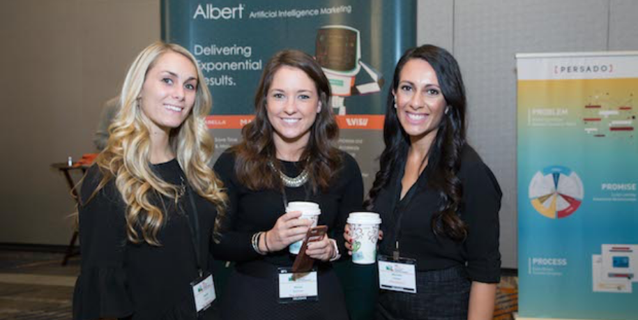 Three women at a conference